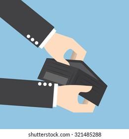 Businessman holding an empty wallet