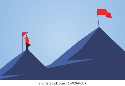 Businessman holding a flag standing on the top of the mountain, looking to another higher mountain, business goals and challenges
