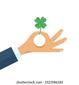 Businessman holding a four leaf lucky green clover. Good luck and lucky charm symbol. Flat style cartoon colorful concept vector illustration isolated on white background.