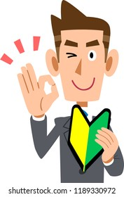 A businessman holding a novice mark on his left hand and showing an OK sign with his right hand