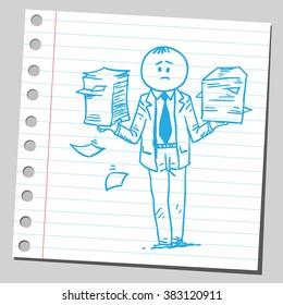 Businessman holding paper piles