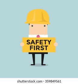 Businessman holding safety first sign vector