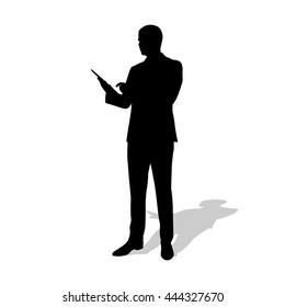 Businessman holds tablet in hand. Standing man in suit, vector silhouette