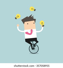 Businessman juggling light bulb while cycling