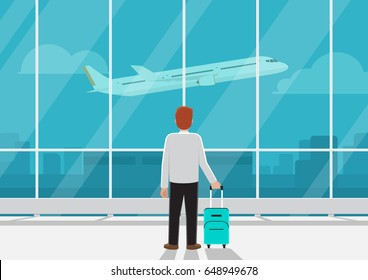 Businessman with luggage in airport looking at airplane in the sky. Business transportation or missed the flight concept.