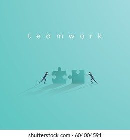 Businessman pushing jigsaw puzzle to complete it. Business teamwork concept vector symbol. Idea of cooperation and collaboration. Eps10 vector illustration.