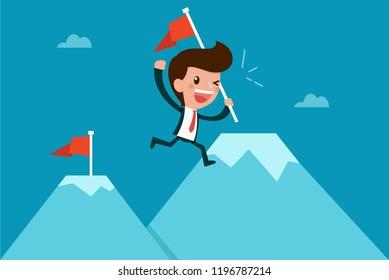 Businessman reaching top of mountain.
