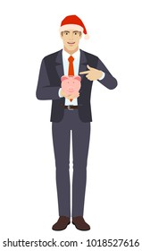Businessman in Santa hat pointing at a piggy bank. Full length portrait of businessman in a flat style. Vector illustration.