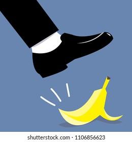 businessman shoe step on banana peel.concept of falling