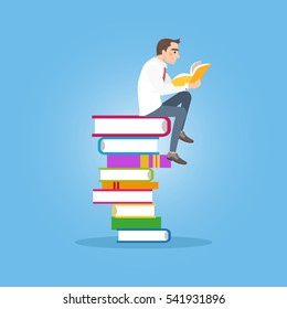 Businessman sitting and holding an open book in his hands. Student sitting on a pile of red books.