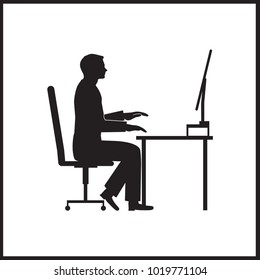 Businessman sitting on office chair at table and working on computer. Side view. Vector silhouette. Man typing in office at desk and staring into monitor