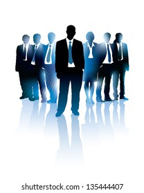 Businessman is standing in front of a group of people.