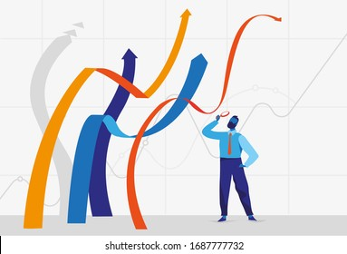 Businessman standing near growing graphs lines and looking at them through the magnifying glass