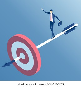 businessman standing on the arrow hit the target. the employee goes to the center of the target, an arrow released from a bow. the business concept of accuracy and purpose