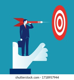 Businessman standing on a big hand holding an arrow about to throw it to the goal isolated on blue background. New business goal challenge concept. EPS vector illustration, flat lay minimalistic style