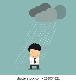 Businessman standing in the rain.Concept of pessimist businessman for the crisis