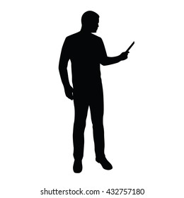 Businessman stands and reads news on tablet or mobile phone. Man with smart phone vector silhouette