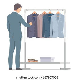 Businessman in suit near rack with clothes. Vector isolated illustration on white background