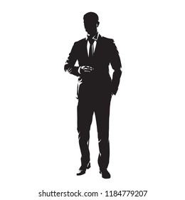 Businessman in suit standing with one hand in pocket. Isolated vector silhouette, front view. Business people