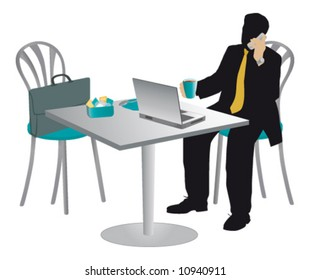Businessman at a table drinking cappuccino and talking on mobile.