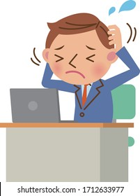 Businessman using laptop at desk (image of worries and stress)