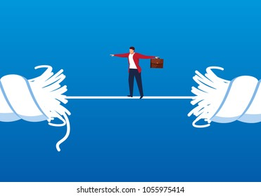 Businessman walking on a rope that is about to break