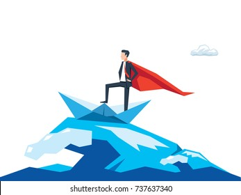The businessman wears cape on top of paper boat standing with mighty pose with ocean wave