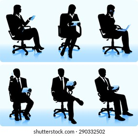 Businessmen in chairs with computers