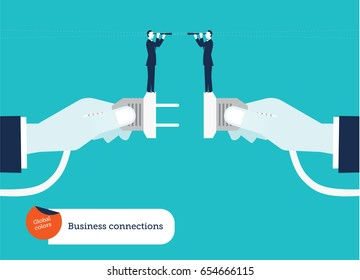 Businessmen's hand connecting socket and plug with two businessmen and spyglass