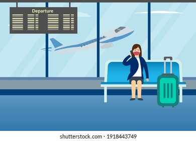 Businesswoman making a phone call while sitting on the lounge at the airport terminal