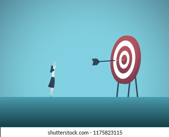 Businesswoman scoring bullseye with dart vector concept. Symbol of success, victory, achievement of goals and objectives, skill. Eps10 vector illustration.