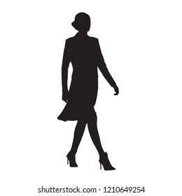 Businesswoman walking, side view, isolated vector silhouette. Business people