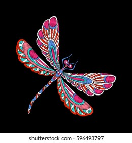 Butterfly. Embroidery. Embroidered design element in vintage style on a black background. Stock vector illustration.