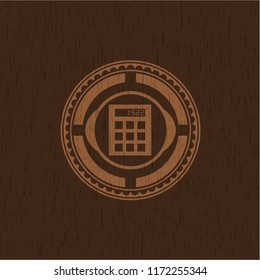 calculator icon inside wood emblem. Vintage.