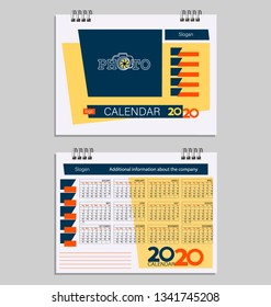 Calendar 2020 with place for photo. Week starts with sunday. Design template using yellow, red and blue colors on a light background. Desktop calendar template.