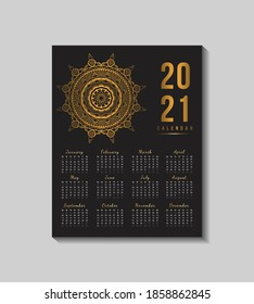 Calendar 2021 elegant gold text with ornamental mandala. New year calendar with black background illustration with light.