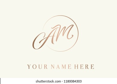 AM calligraphic monogram in rose gold metallic color.Logo with elegant letter a and letter m in a circular frame.Emblem style lettering vector icon isolated on light background.