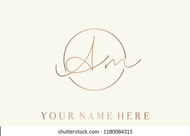 AM calligraphic monogram.Logo with elegant letter a and letter m in a circular frame.Emblem style lettering vector icon in rose gold metallic color, isolated on light background.
