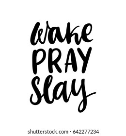 """The calligraphic quote  """"Wake, pray, slay"""" handwritten of black ink on a white background."""