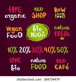 Calligraphic retro style set of 100% bio. Font logo. Hand-drawn lettering. Quote. Handwritten words: free organic, eco shop, raw food, vegan, nature fresh, love. Logotype for shop, business, interior.