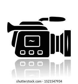 Camera drop shadow black glyph icon. Camcorder. Videotaping, video recording. Filmmaking professional equipment. Video production, cinematography industry. Isolated vector illustration