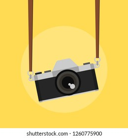 The camera is hanging with camera strap. Vector illustration.