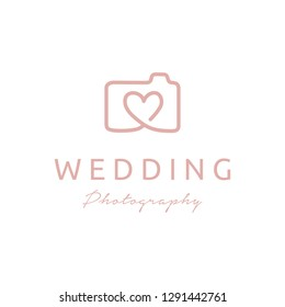 Camera and Heart symbol for Wedding photography logo