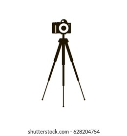 Camera  on a tripod, vector illustration in black on a white background