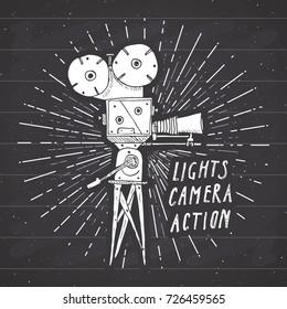 Camera vintage label, Hand drawn sketch, grunge textured retro badge, typography design t-shirt print, vector illustration on chalkboard background.