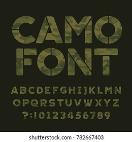 Camo alphabet font. Type letters and numbers on a dark green background. Vector typography for your design.