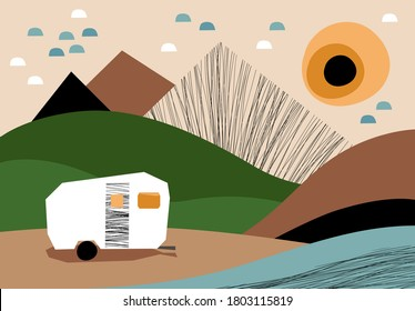 Camping trailer on the river bank in the mountains