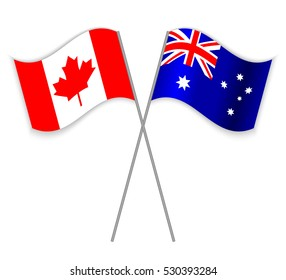 Canadian and Australian crossed flags. Canada combined with Australia isolated on white. Language learning, international business or travel concept.