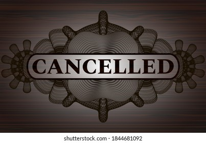 Cancelled text inside Guilloche dark wooden emblem. Brown classic background. Illustration.