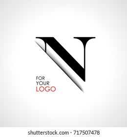 Capital n letter is inserted in the paper slot. To create logos, emblems, monograms